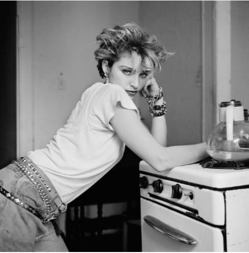 """According to Richard Corman: This is the first photo I took of Madonna in her Lower Eastside apartment. She just got up and leaned on that stove, and I took the shot. There's nobody that can lean on a stove like that."""